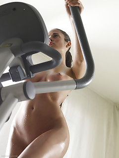 Hegre Art. Busty Muriel works out at the gym naked