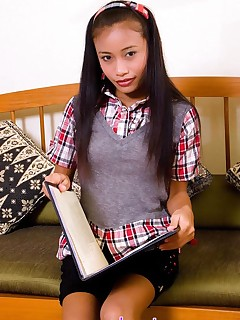 Thainee. Schoolgirl Thainee is horny after a long day and strips to show her tight body