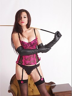 Ladies In Leather Gloves. Sexy brunette Tina is dressed in her long black leather gloves posing as femdom with a huge cane
