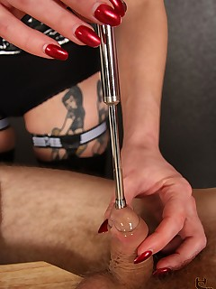 CBT and Ball Busting. Femdom Nyxon keeps putting bigger sounds down her slave's cock.