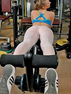 Pantyhose Sports. Hottie has gym fitness time in white pantyhose