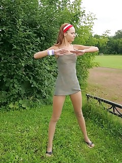 Pantyhose Sports. Slender gal in tights limbers up outdoors