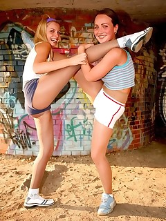 Pantyhose Sports. Two gymnasts train up in tights outdoors