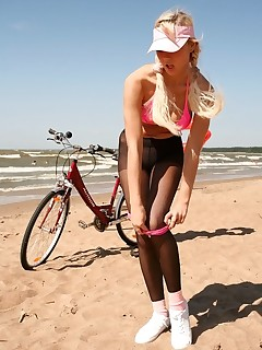 Pantyhose Sports. Blonde Victoria doing pantyhose aerobics at seashore